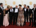 """From left, Actors RJ Mitte, Anna Gunn, Dean Norris, Jonathan Banks, Betsy Brandt, Bryan Cranston, Aaron Paul, and Bob Odenkirk of """"Breaking Bad"""" pose backstage with the award for outstanding drama series at the 65th Primetime Emmy Awards at Nokia Theatre on Sunday Sept. 22, 2013, in Los Angeles."""