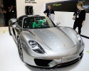 People look at the 2015 Porsche 918 Spyder plug-in hybrid sports car at the Los Angeles Auto Show on Thursday, Nov. 21, 2013, in Los Angeles.