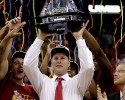 Iowa State coach Fred Hoiberg holds up the trophy after Iowa State defeated Baylor 75-65 in an NCAA college basketball game for the Big 12 men's tournament title, Saturday, March 15, 2014, in Kansas City, Mo.