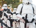 "Star Wars fan dressed as stormtroopers parade along Tunis' stately, tree-lined Bourguiba Avenue, in Tunisia, Wednesday, April 30, 2014. The empire was not striking back against the poster child for Arab democracy — just an innovative campaign to encourage tourists to return to this sunny desert-and-beach nation in North Africa. ""We came here to Tunis to help save the Star Wars sites in Matmata and Tozeur and convince people to return to Tunisia,"" said Ingo Kaiser, head of a Star Wars fan club in Europe, referring to the movie sets that are slowly being covered up by sand in the Tunisian desert."