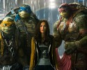 "This image released by Paramount Pictures shows, from left, Michelangelo, Leonardo, Megan Fox, as April O'Neil, Raphael, and Donatello in a scene from ""Teenage Mutant Ninja Turtles."""