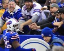 Buffalo Bills safety Da'Norris Searcy (25) celebrates with fans after a touchdown by teammate Jerry Hughes during the second half of an NFL football game against the Cleveland Browns, Sunday, Nov. 30, 2014, in Orchard Park, N.Y.