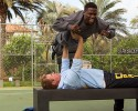 "In this image released by Warner Bros. Entertainment Inc., Kevin Hart, top, and Will Ferrell appear in a scene from ""Get Hard."""